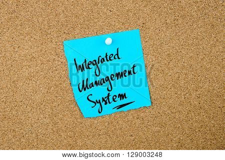 Integrated Management System Written On Blue Paper Note