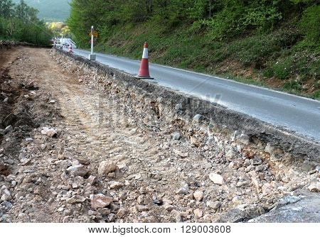 picture of an apshalt  road in repair