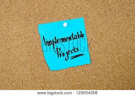 Implementable Projects Written On Blue Paper Note