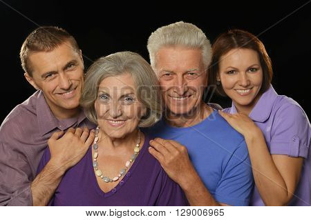 Portrait of a cute family portrait with senior parents