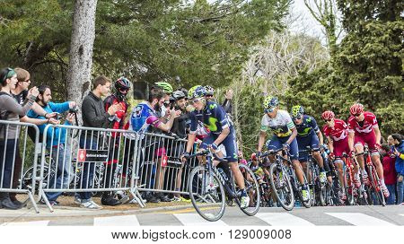 Barcelona Spain - March 27 2016: The Colombian cyclist Nairo Quintana of Movistar Team riding in the peloton during Volta Ciclista a Catalunya on the top of Montjuic in Bracelona Spain on March 27 2016. Quintana was te winner of the race.