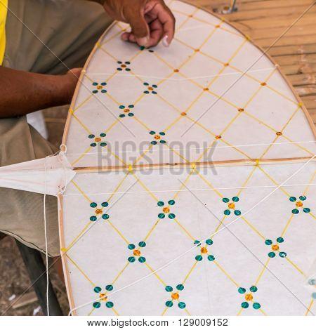 Man is making Thai kite, Chula kite