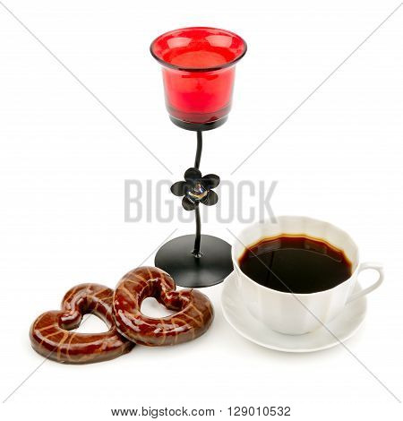 cup with coffee biscuits and a candlestick isolated on a white background