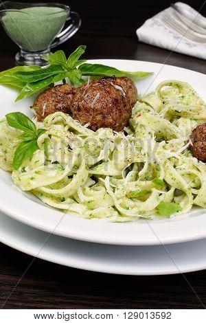 Meatballs with pasta sauce avocado parmesan and basil