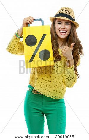 Smiling Woman In Hat Showing Shopping Bag And Thumbs Up