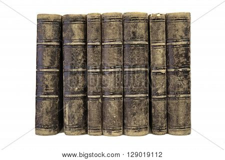 Old Shabby Books In A Row Isolated On White