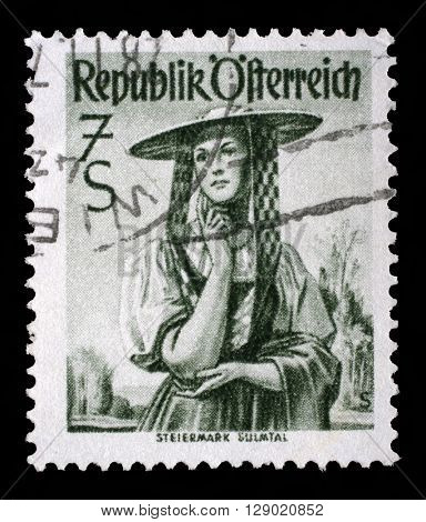 ZAGREB, CROATIA - SEPTEMBER 18: a stamp printed in the Austria shows Woman from Steiermark, Sulm Valley, Regional Costume, circa 1952, on September 18, 2014, Zagreb, Croatia