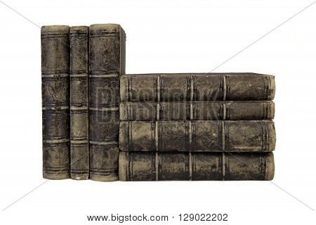 Seven Old Shabby Books In Stack Isolated On White