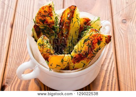 Fried Potatoes With Dill On A Wooden Background