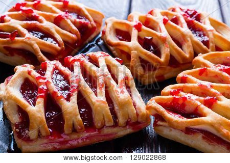 Strudel With Jam On A Black Background Closeup