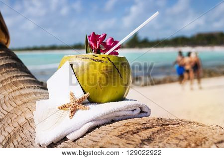 Coconut cocktail starfish tropical Caribbean beach refreshment and towel