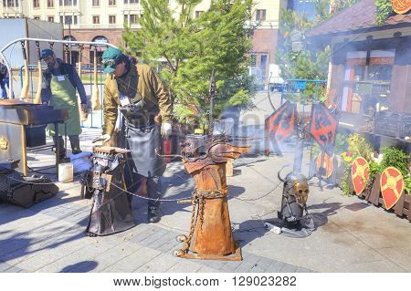 MOSCOW RUSSIA - April 24.2016: Blacksmith works at the fair at the Theatrical Square in the city center