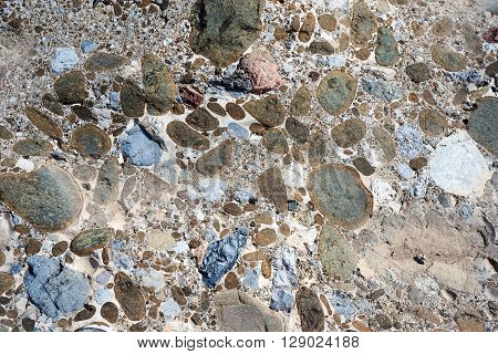 Pebbles bound together in natural cement resembling concrete