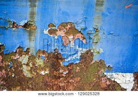 Old and damaged cracked paint on tin surfaces.