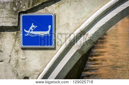 Gondola street sign on a bridge over the canal in Venice, Italy