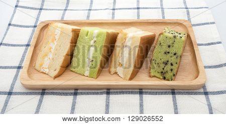 four chiffon cake on wood plate to serve