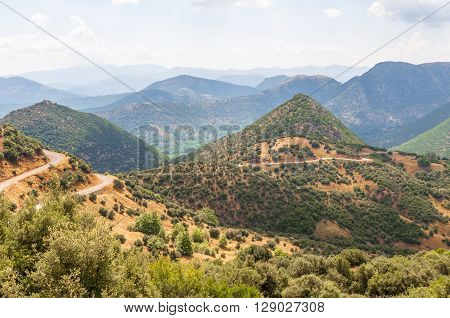 The hills in the Central part of the Peloponnese covered with the midday haze. Greece.