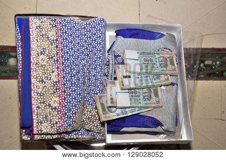 Women Saree With Bundle Of Indian Rupee