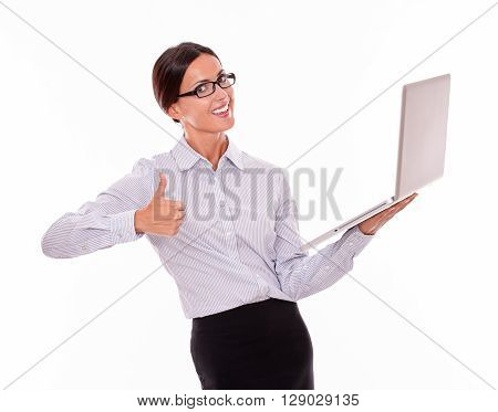 Smiling Brunette Businesswoman With A Laptop