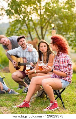 Women and men socializing in nature