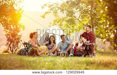young friends have good time on camping trip, relaxing vacation with fun