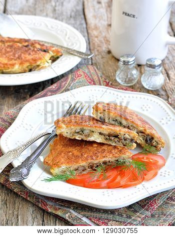 Matzo Brei a Jewish recipe of dampened matzo crackers fried with eggs, mushrooms, onions and dill.