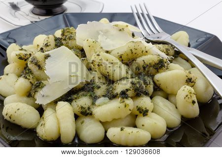 Gnocchi pasta close up with parmesan cheese and pesto