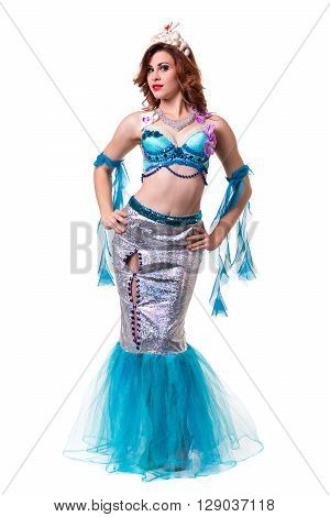 Carnival dancer woman dressed as a mermaid posing, isolated on white background in full length.