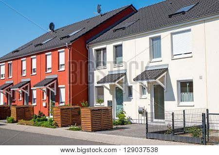 Red and white serial houses seen in Berlin, Germany