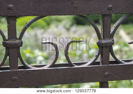 Metal fence with blurred background, artistic metal border