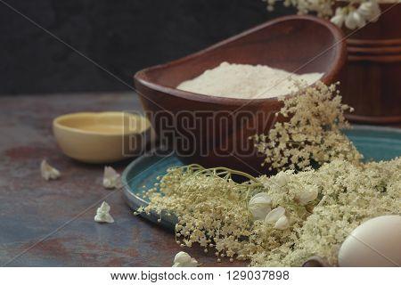 Elder flower pancakes. Preparation of pancake batter with various edible flower ingredients.Macro, selective focus, vintage toned image