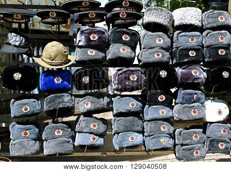MOSCOW, RUSSIA - MAY 7, 2016: Many multi-colored military hats Soviet and Russian army and navy