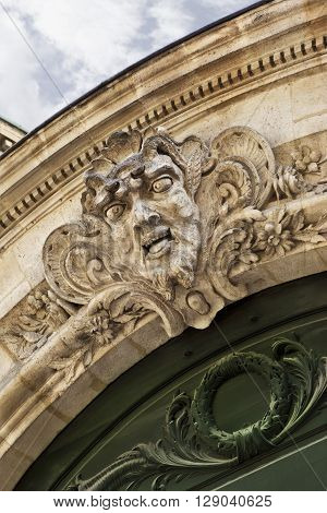 Stoned facade and sculpture of a French mansion in Bordeaux