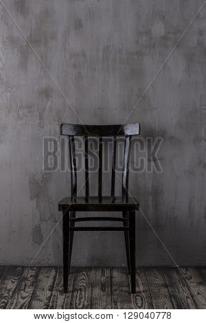 Old wooden chair in the empty room