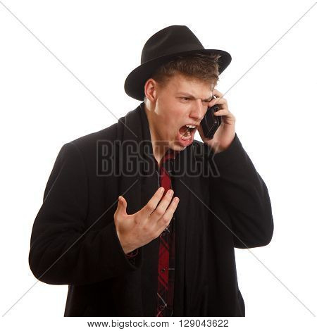 An young adult screaming on the phone