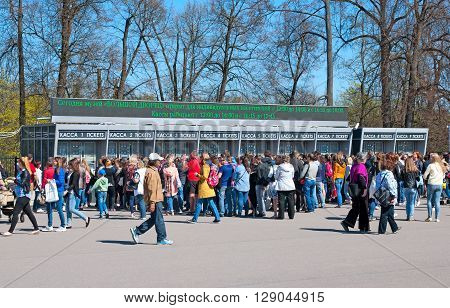 PETERHOF, SAINT-PETERSBURG, RUSSIA - MAY 8, 2016:  People near the ticket office of The State Museum Preserve Peterhof next to the entrance to the park and fountains