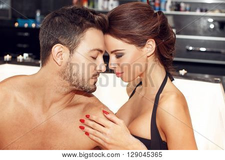 Sensual couple in jacuzzi portrait put heads together honeymoon