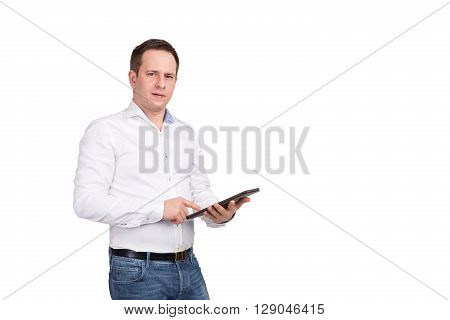 Serious Young Male Executive Using Digital Tablet Against White Background, Looking At Camera