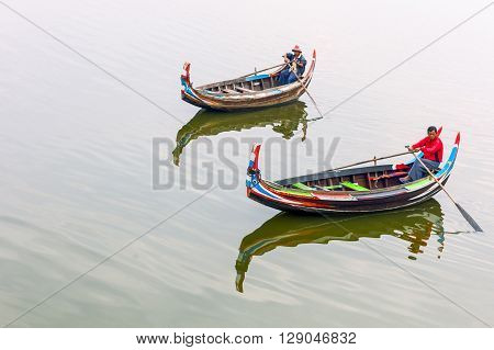 Mandalay Myanmar - January 13 2012: Fishermen on the Tuang lake.