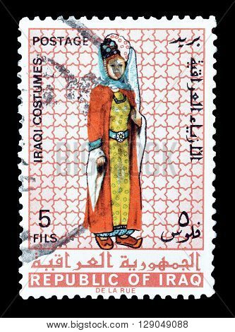 IRAQ - CIRCA 1967 : Cancelled postage stamp printed by Iraq, that shows Iraqi costume.