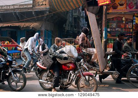 VARANASI, INDIA - JAN 4, 2013: Traffic jam on the street with a lot of motorcycles and bicycles on January 4, 2013 in ancient indian city Varanasi. Varanasi urban agglomeration has a population 15 million