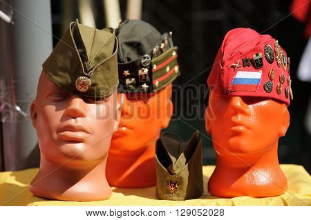 Orel Russia - May 9 2016: Celebration of 71th anniversary of the Victory Day (WWII). Dummy heads in soviet field caps closeup