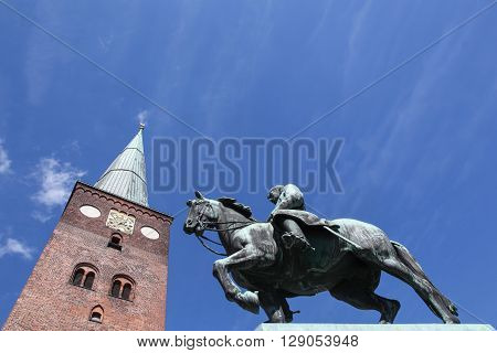 Cathedral of Aarhus in Denmark with the statue of king Christian