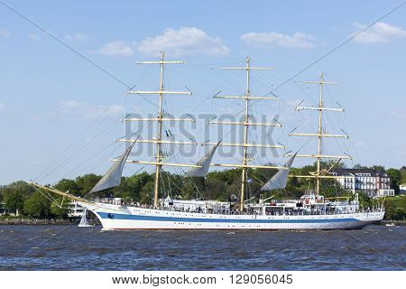 Hamburg, Germany - May 8, 2016: Russian three-masted sailing ship Sts MIR on the Elbe river during the departure parade of 827th hamburg Port Anniversary