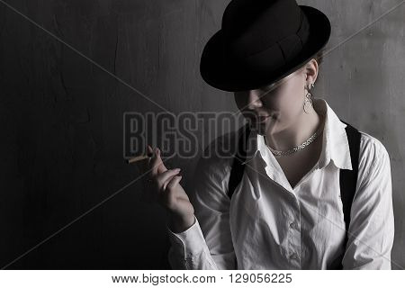 Mysterious beaytiful stranger with cigar in hat