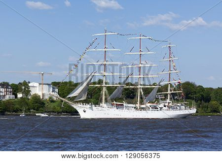 Hamburg, Germany - May 8, 2016: Polish tall ship Dar Mlodziezy on the Elbe river during the departure parade of 827th Hamburg Port Anniversary