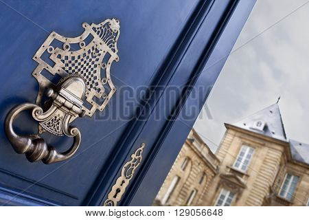 Door and knocker of a French mansion in Bordeaux