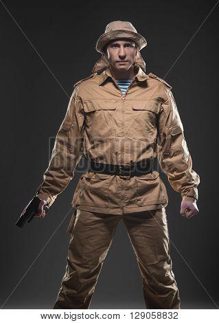 Soldier With A Gun On Dark Background