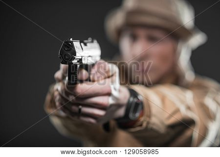 Military war conflict soldiers - Special forces soldier with a gun takes aim on dark background