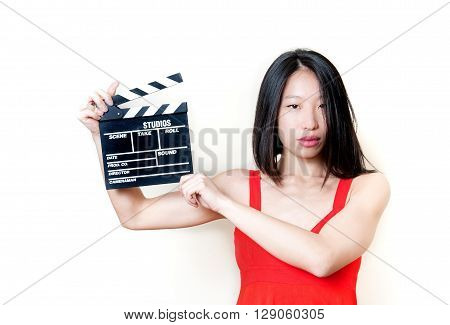 Young Asian Woman And Movie Clapper Board